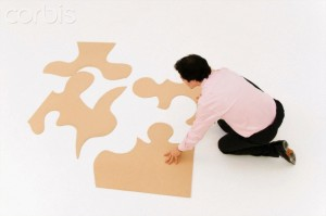 Business man looks to finish puzzle